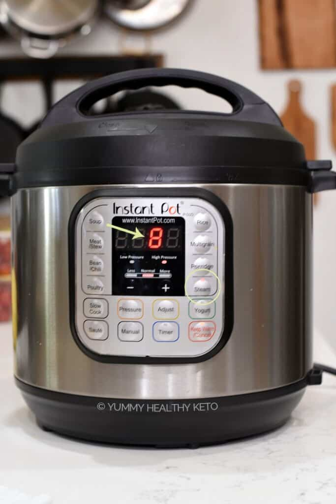 An Instant Pot set for 8 minutes on high pressure using the steam function.