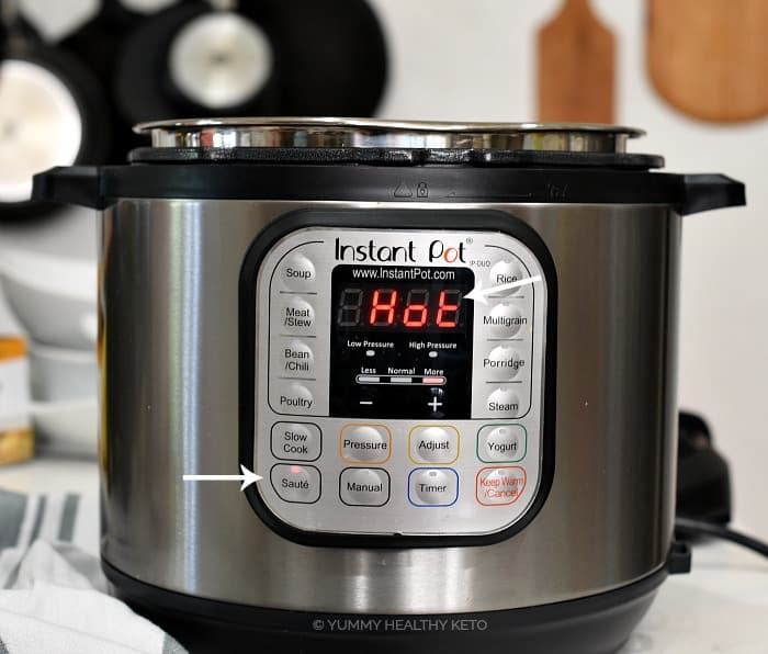 An Instant Pot with the saute button pressed and Hot on the display.