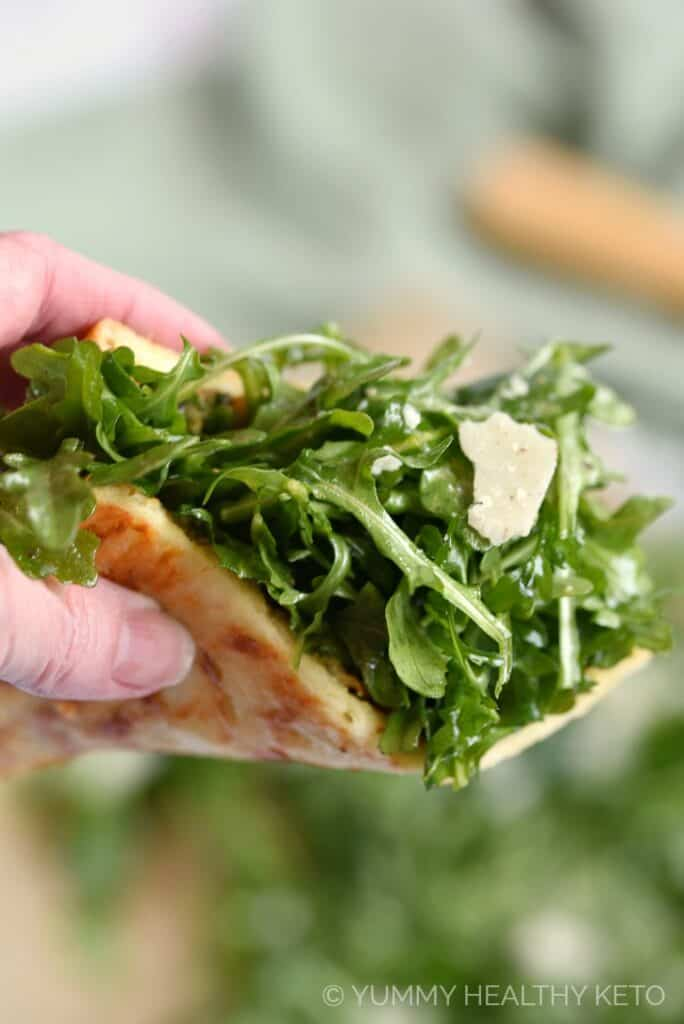 So many amazing textures and flavors in this Keto Pesto Pizza with Fresh Arugula, your family will love it!