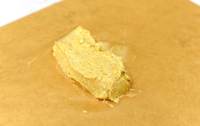 Form a log with the compound butter on a piece of parchment paper.