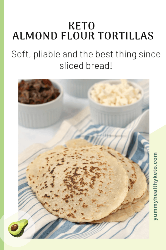 Pinterest Graphic showing a stack of Keto Almond Flour Tortillas with bowls of lettuce, cheese and shredded beef in the background.