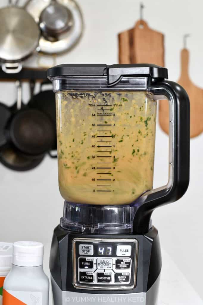 Healthy Pumpkin Smoothie being blended in a blender.