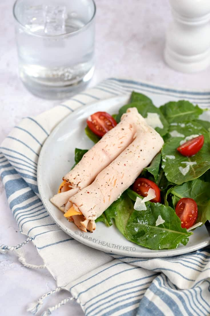 Two Lunch Meat Roll Ups on a bed of salad