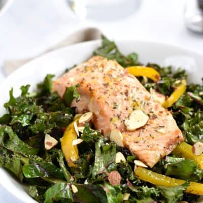 Broiled Salmon tops chopped kale, asparagus and bell pepper strips Salad tossed with citrus vinaigrette