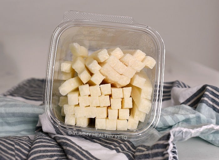 Jicama cut into strips in a clear plastic container.