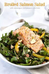 A Broiled Salmon fillet tops an asparagus, bell pepper Salad that was tossed with citrus vinaigrette