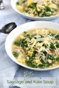 Two white bowls filled with Sausage and Kale Soup topped with grated Parmesan cheese