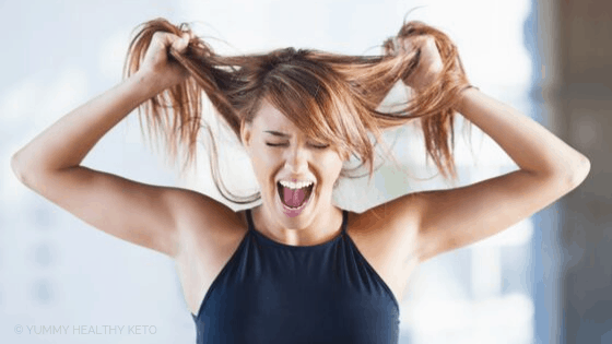 Stressed woman pulling on her hair