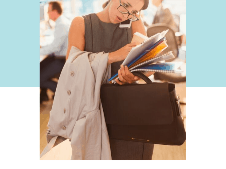 Stress Hormones and Weight Loss with title graphic below stressed woman on the phone carrying a stack of folders